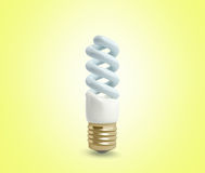 Econom Lighting Bulb 3d render on yellow background Royalty Free Stock Photography