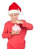 Economia adorável da criança com chapéu de Santa Foto de Stock Royalty Free