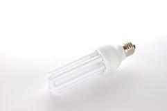 Economic bulb. The white economic bulb on the white background Stock Image