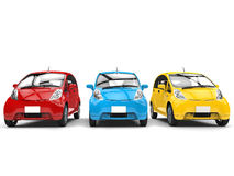 Economic compact electric cars in primary colors. Isolated on white background Royalty Free Stock Image