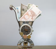 Economic crisis. Denominations dollars and euro in an old metal meat grinder Royalty Free Stock Photos