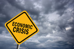 Economic crisis. Sign over gloomy sky Stock Images