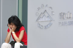 Economic crisis. A policyholder of Nan Shan Life Insurance Co worry about losing savings  on Sep. 17, 2008 in Taiwan.  Nan Shan Life Insurance Co is a subsidiary Royalty Free Stock Photos
