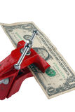 Economic crisis. One dollar clamped in a vice on the white isolated background Royalty Free Stock Photo