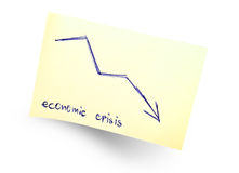 Economic crisis. Sticky note with economic crisis message Royalty Free Stock Images