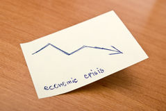 Economic crisis. Sticky note with economic crisis message Stock Images