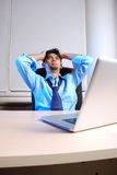 Economic Crisis. Very gloomy businessman in office environment with laptop Stock Photo
