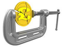 The economic crisis of the Great Britain. Concept. Cracked gold coin with the symbol of the pound sterling is clamped in the clamp. The concept of financial Stock Photos