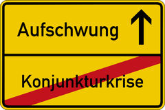 Economic crisis and recovery. The German words for economic crisis and recovery (Konjunkturkrise and Aufschwung) on a road sign Royalty Free Stock Photo