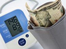 Economic depression. Portrait on banknote looks sad with the measurement of blood pressure gauge, economic depression concept Royalty Free Stock Images