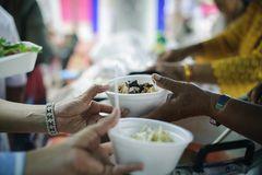 The economic downturn causes food shortages : Donate Food with Love and Hope to the Poor: The concept of food is essential to life. The concept of hope: Hand stock image