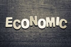 Economic. Topic by wood letters Royalty Free Stock Photography
