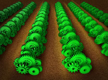 Economic growth. Represented by machine gears and cogs in the shape of a farm field with green crops growing on the land using the symbol and concept of Royalty Free Stock Image