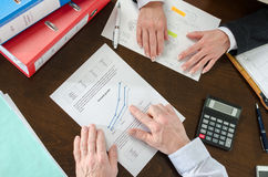 Economic growth. Businesspeople discussing on economic growth stock images