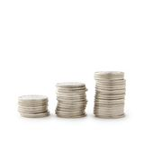Economic growth. Is symbolized by three stacks of coins on white background royalty free stock photography