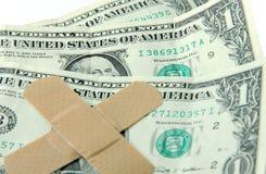 Economic Hardship. Dollar bills with band-aids = economic hardship Stock Photos