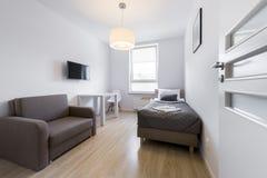 Economic, modern sleeping room interior design Stock Images