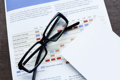 Economic plan and glasses Stock Photo
