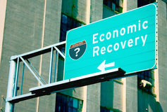 Economic Recovery. An interstate directional sign with the words Economic Recovery on it. A question mark is in place of the interstate number on the shield to Stock Images