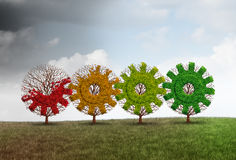Economic Recovery Concept. Business growth metaphor as a group of recovering trees shaped as a gear or cog as a financial revitalization metaphor with 3D Royalty Free Stock Photo