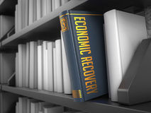 Economic Recovery - Title of Book. Finance Concept. Economic Recovery - Grey Book on the Black Bookshelf between white ones. Finance Concept Royalty Free Stock Photo