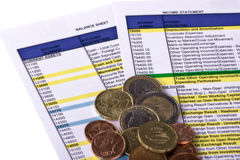 Economic reports and coins Stock Photo