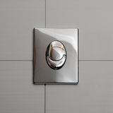 Economic toilet flush knob stock photography