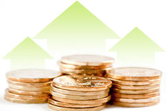 Economic Upturn. A horizontal format image of coins with green arrows pointing up to show the rise of the economy and the increase in currency value stock photography