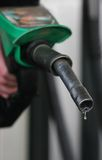 Economical. Drop fuel drips at the petrol station Royalty Free Stock Photography