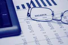 Economical balance sheet. With a diagram and glasses on it Stock Image