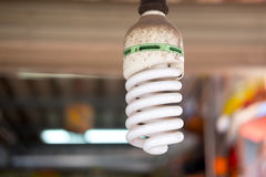 Economical energy saving spiral fluorescent lamp. Close up of  old economical energy saving spiral fluorescent lamp Royalty Free Stock Photo