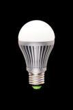 Economical LED lamp. Chambered E27 on a black background Stock Image