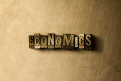 ECONOMICS - close-up of grungy vintage typeset word on metal backdrop. Royalty free stock illustration.  Can be used for online banner ads and direct mail Stock Photography