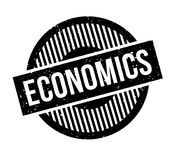 Economics rubber stamp. Grunge design with dust scratches. Effects can be easily removed for a clean, crisp look. Color is easily changed Stock Images