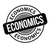 Economics rubber stamp. Grunge design with dust scratches. Effects can be easily removed for a clean, crisp look. Color is easily changed Royalty Free Stock Photography