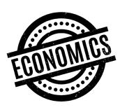 Economics rubber stamp. Grunge design with dust scratches. Effects can be easily removed for a clean, crisp look. Color is easily changed Royalty Free Stock Images