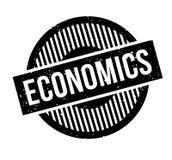 Economics rubber stamp Stock Photos