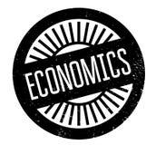 Economics rubber stamp Stock Photo