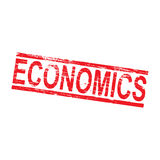 Economics Rubber Stamp. Economics grungy rubber stamp symbol Stock Image