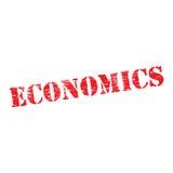 Economics Stencil. Economics grungy stencilled word symbol Stock Image