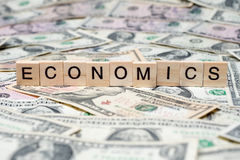 ECONOMICS in wooden block Royalty Free Stock Image