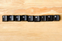 Economics word. With keyboard buttons Royalty Free Stock Image
