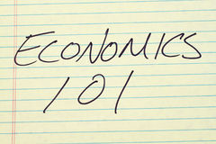 Economics 101 On A Yellow Legal Pad. The words `Economics 101` on a yellow legal pad royalty free stock images