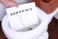 Economie in het toilet stock foto