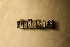 ECONOMIES - close-up of grungy vintage typeset word on metal backdrop Stock Photo