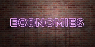 ECONOMIES - fluorescent Neon tube Sign on brickwork - Front view - 3D rendered royalty free stock picture Royalty Free Stock Photo