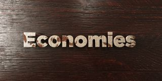 Economies - grungy wooden headline on Maple  - 3D rendered royalty free stock image Royalty Free Stock Photos