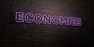 ECONOMIES -Realistic Neon Sign on Brick Wall background - 3D rendered royalty free stock image Royalty Free Stock Photo