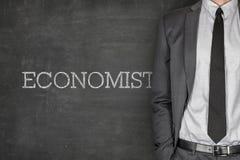 Economist on blackboard Stock Photo