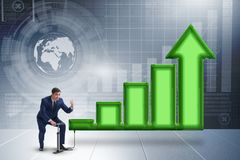 The economist pumping economic growth in economy Stock Photo